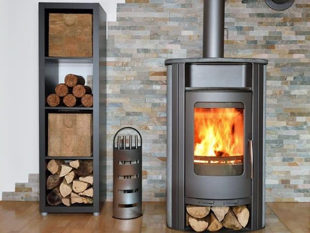 Design houtkachel met opslag